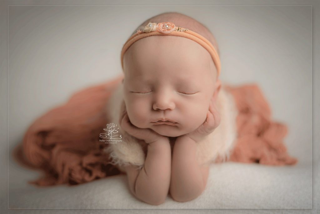 newborn baby photography froggie pose peach colour palette