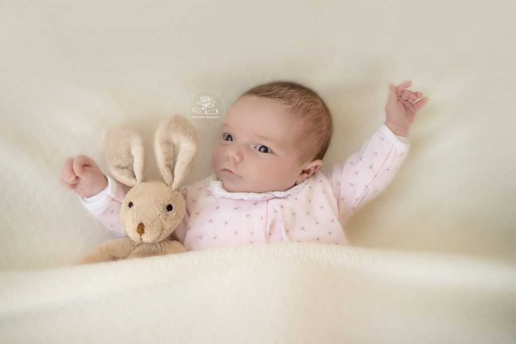 Newborn photography lifestyle pose baby with teddy